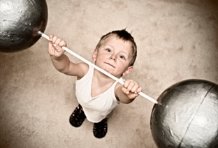 child lifting weights