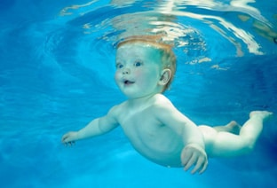 Ginger Baby swimming