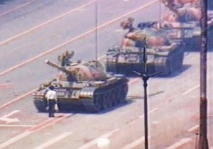 Wise tiananmen square man in front of tank